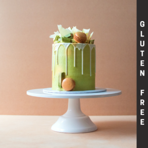 Gluten Free matcha green tea cake with white chocolate drip and macarons