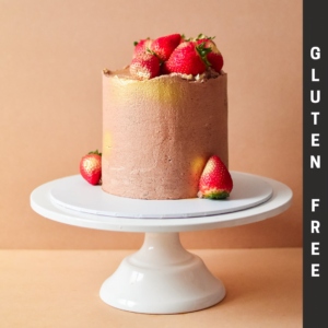 GF chocolate and strawberry cake with gold spray