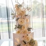 Tiered white wedding cake with flowers by Ruwi's Cakes Melbourne
