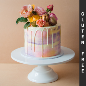 Gluten free pink and purple white chocolate drip cake with flowers