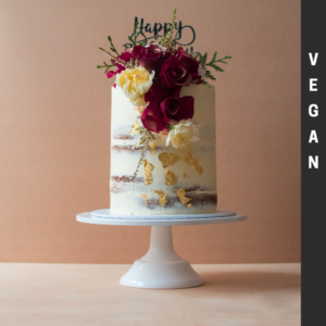 Vegan naked cake with red flowers
