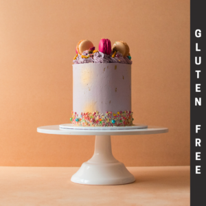 Gluten Free purple cake with macaroons and sprinkles