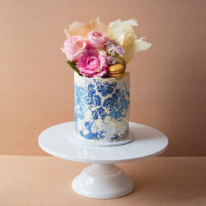 Blue Vintage cake with silver flakes, flowers and white chocolate shards on top