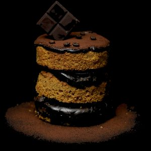 Coffee and jamaican chocolate with chocolate block on top the cake