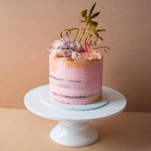 Pink semi-naked cake with fairy cake topper