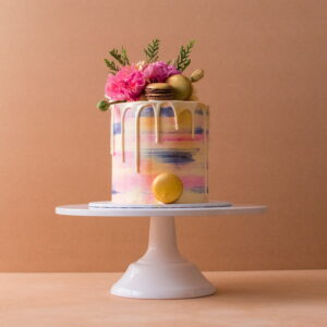 Macaroon and white chocolate drip cake with flowers