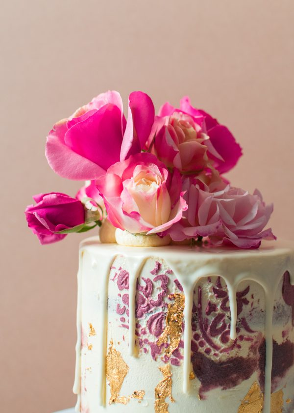 A close up image of a vintage cake with flowers on top