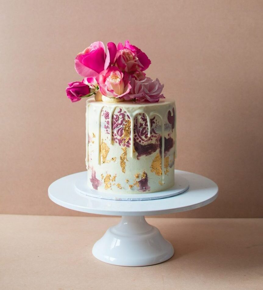 Small birthday cake with patterns and flowers on top