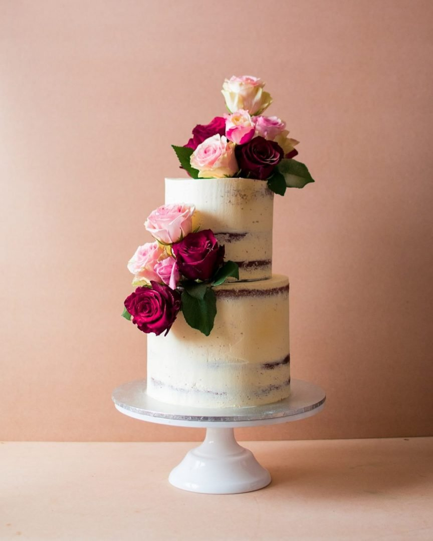 Nude white frosted wedding cake with flowers