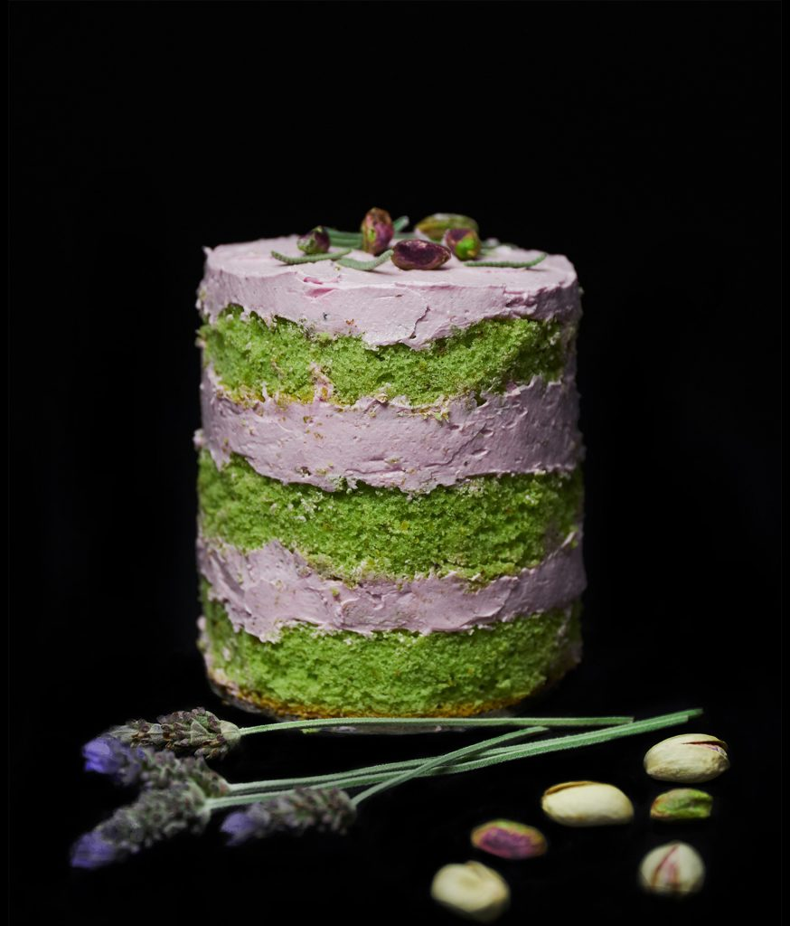 Pistachio sponge and lavender cream mini cake with pistachios on top