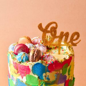 Close up image of colourful cake with one cake topper