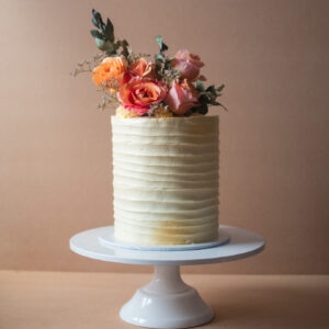 Vintage birthday cake with orange rustic flowers