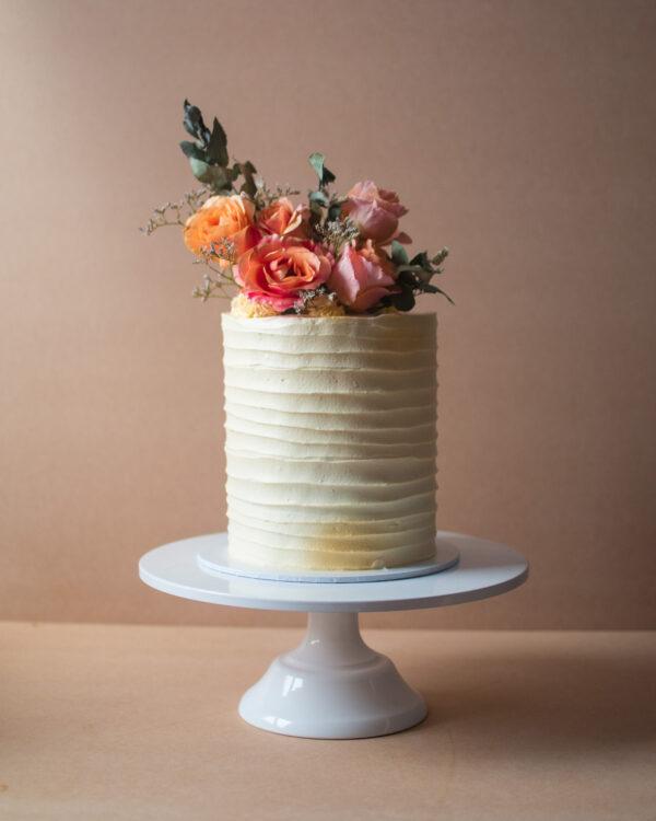 Vintage birthday cake with orange rustic flowers
