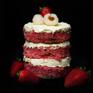 Strawberry sponge and lychee mini cake with lychee and strawberry on top