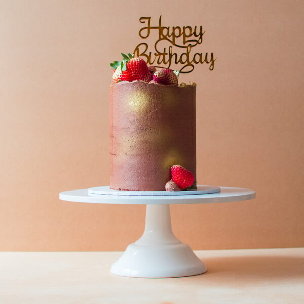 Chocolate and strawberry cake with happy birthday topper