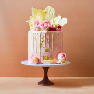 Pink cake with white chocolate drip and shards