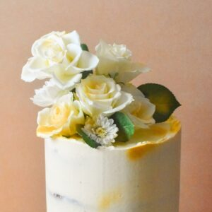 Close up of white cake with white flowers