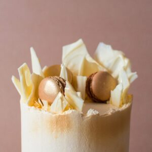 a close up image of a birthday cake with white chocolate shards on top